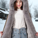 Women's solid brown parka with voluminous fox fur hood and frontlines
