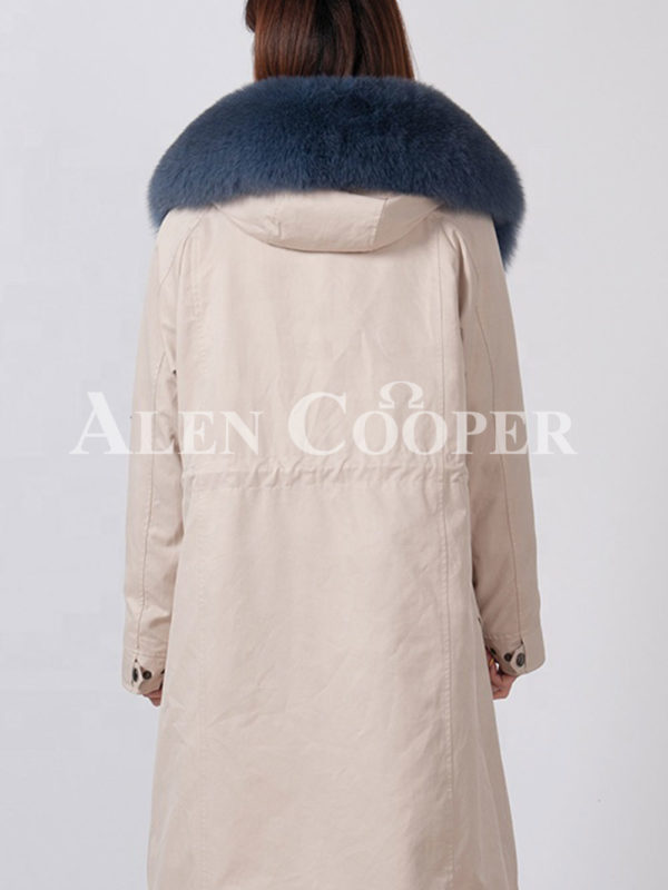 Beautiful long warm winter parka with fur hood for women back side view
