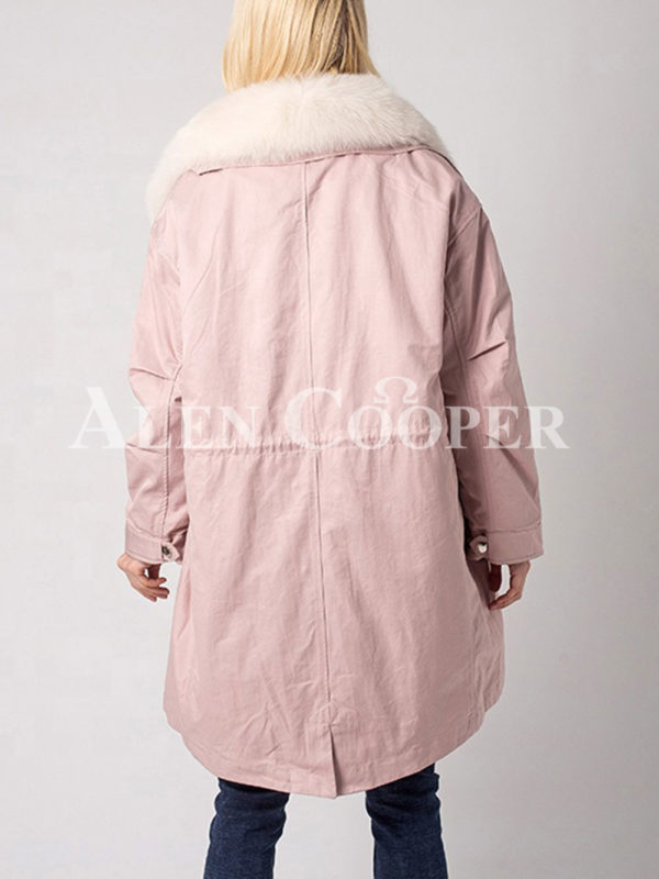 Long and comfortable super warm fur hooded winter parka for women in pink side view