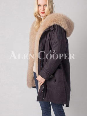 Women's long and casual food hooded winter parka in black side view