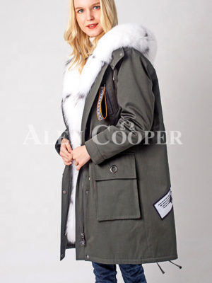 Women's thick warm winter fashionable parka with long raccoon fur collar sideview