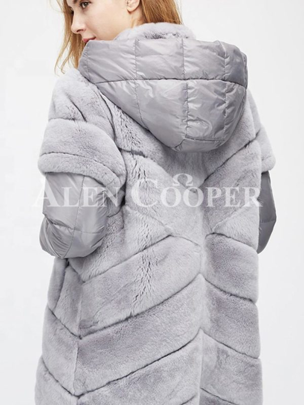 Stylish real fur coat with detachable hood and polyester sleeves in grey back side view