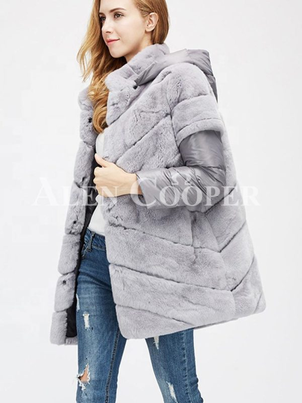 Stylish real fur coat with detachable hood and polyester sleeves side view