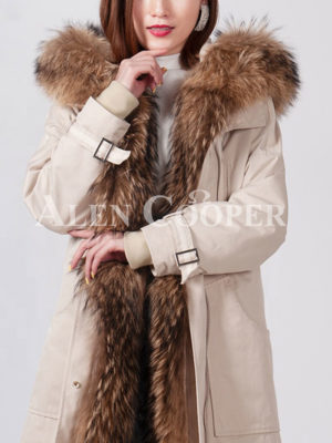 Women's stylish warm winter parka with long raccoon fur collar and hood