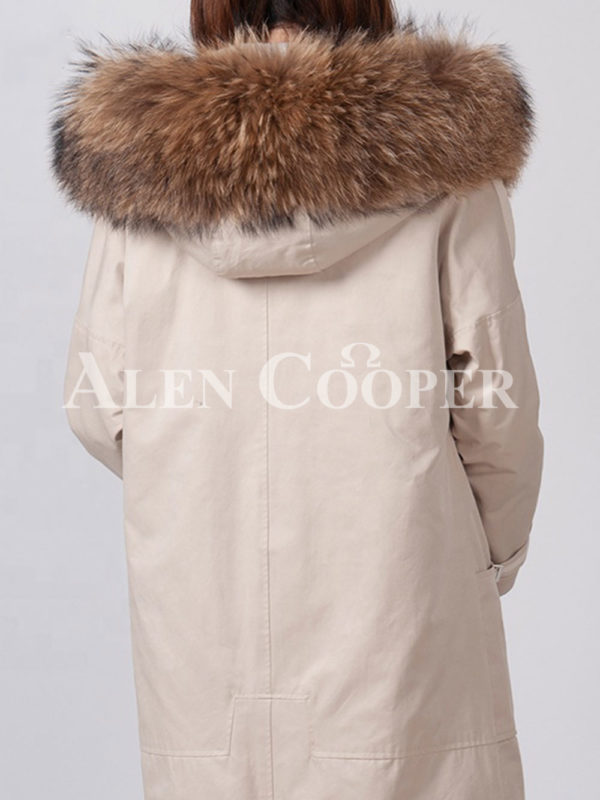 Women's stylish warm winter parka with long raccoon fur collar and hood back side view