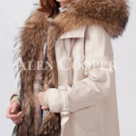 Women's stylish warm winter parka with long raccoon fur collar and hood side view