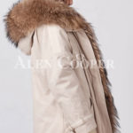 Women's stylish warm winter parka with long raccoon fur collar and hood sideview