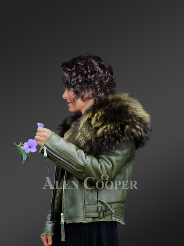 Women's super stylish super soft super warm real leather jacket with raccoon fur collar in green side view New