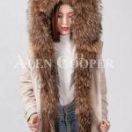 Women stylish warm winter parka with long raccoon fur collar and hood
