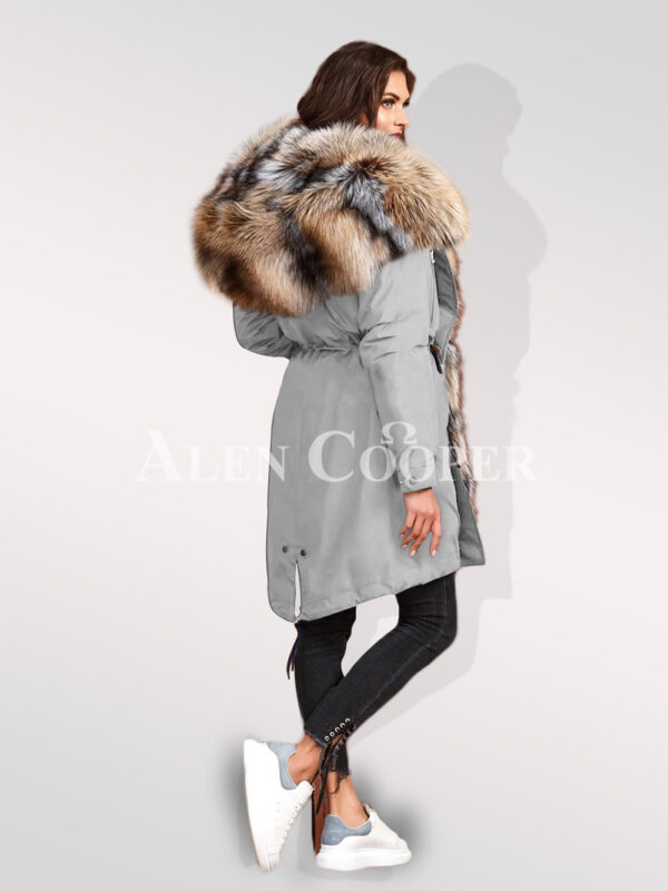 Turn all eyes on you with blue frost fox fur hybrid grey parka convertibles back side view