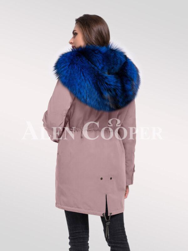 Elegant Arctic fox fur hybrid pink parka convertibles to make women look more graceful back side view