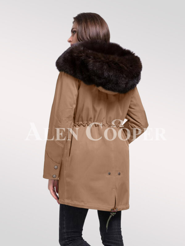 Give in to the fashion revolution with women's Arctic fox fur hybrid beige parka convertibles back side view
