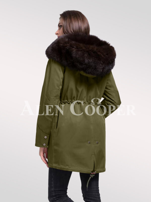 Reinvent yourself with ladies' Arctic fox fur hybrid green parka convertibles back side view