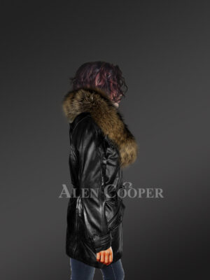 Long leather jacket in black for women with detachable raccoon fur collar with Model side view