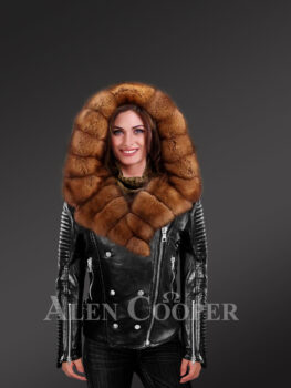 Women's brown leather jacket with fascinating fur collar